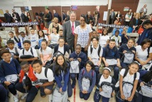 Jackie Joyner-Kersee and David L. Cohen with Olney Elementary School students during Comcast's Internet Essentials 2016 Back to School event