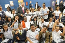 Jackie Joyner-Kersee and David L. Cohen with Saint Malachy School students during Comcast's Internet Essentials 2016 Back to School event