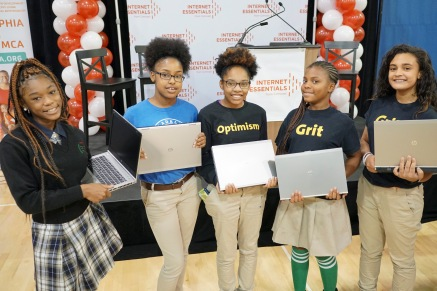 Saint Malachy School students show off their free laptops!