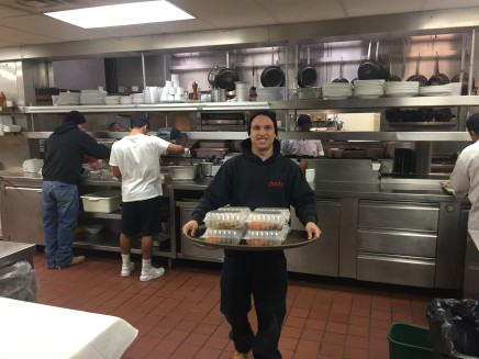 Anthony LoRocco helping prepare the meals.