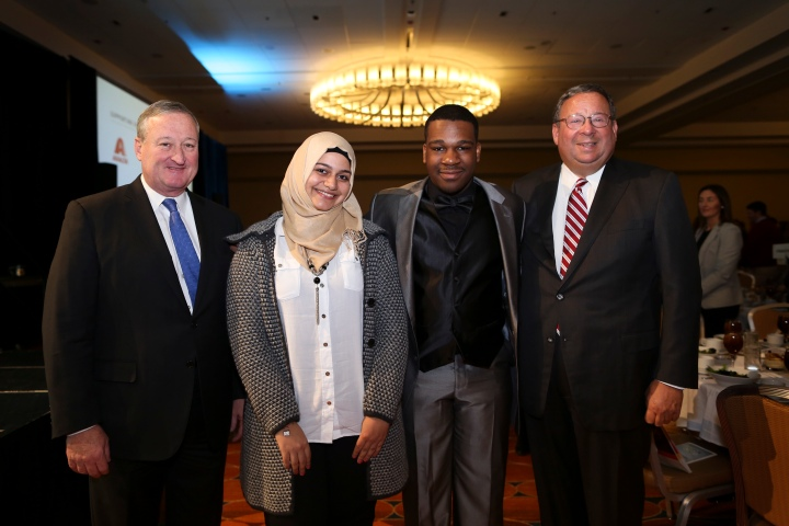 David L. Cohen, Senior Executive Vice President & Chief Diversity Officer poses with the Gustave G. Amsterdam Leadership Award recipients Fakira Awawdeh and Widchard Faustin on Thursday Feb. 2, 2017, during the Chamber of Commerce for Greater Philadelphia's Annual Mayor's Luncheon in Philadelphia.